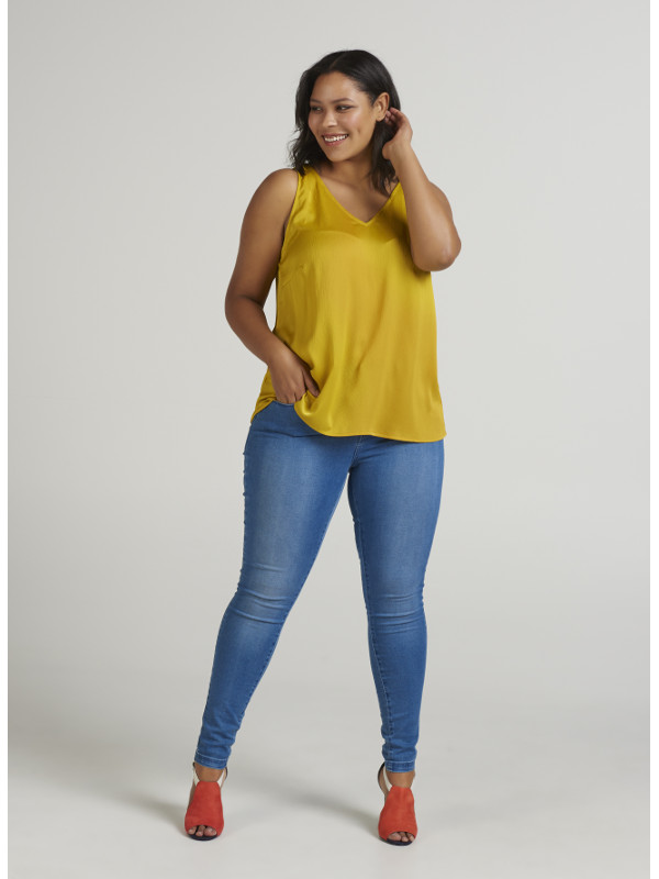 En blus med lyster i gult