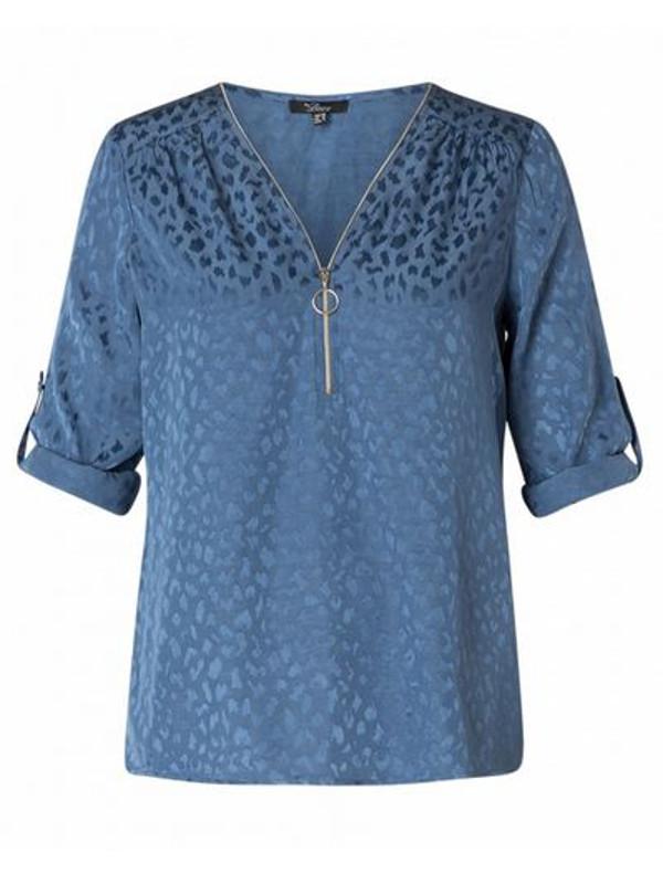 Blus i glastigt mönster som ger lyster